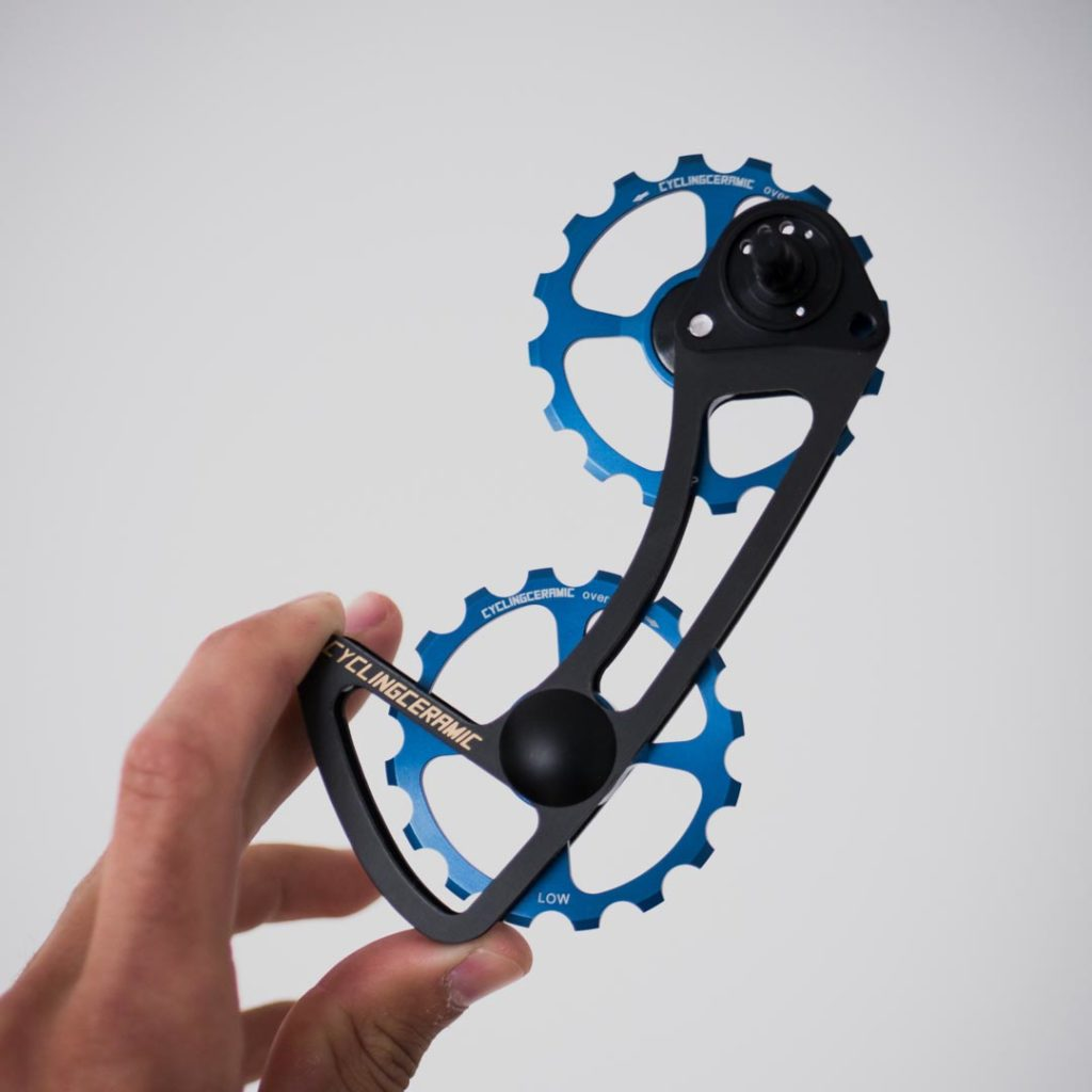 New oversized derailleur cage with deep blue anodized jockey wheels